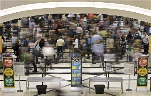 Passengers move through the line at a security checkpoint at Hartsfield-Jackson Atlanta International Airport Thursday, Nov. 18, 2010 in Atlanta.