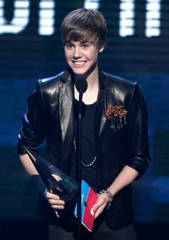 Justin Bieber accepts the award for pop/rock favorite male artist at the 38th Annual American Music Awards on Sunday, Nov. 21, 2010 in Los Angeles. (AP Photo/Matt Sayles)