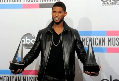 Usher holds his awards backstage at the 38th Annual American Music Awards on Sunday, Nov. 21, 2010 in Los Angeles. (AP Photo/Chris Pizzello)