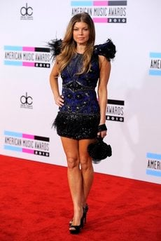 Fergie arrives at the 38th Annual American Music Awards on Sunday, Nov. 21, 2010 in Los Angeles.  (AP Photo/Chris Pizzello)