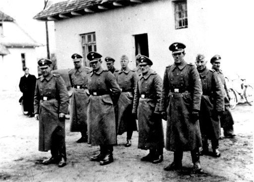 This photo made available by Yad Vashem Photo Archive in Jerusalem shows Nazi guards at Belzec death camp in occupied Poland in 1942. (AP Photo/Yad Vashem Photo Archive)