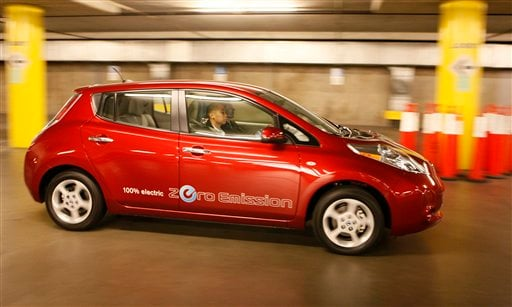 In this file photo taken Nov. 18, 2010, the Nissan Leaf, a 100% electric car, zero emissions vehicle, is test driven at the 2010 Los Angeles Auto Show. Nissan's new electric car, the Leaf, will get the equivalent of 99 miles per gallon in combined city an
