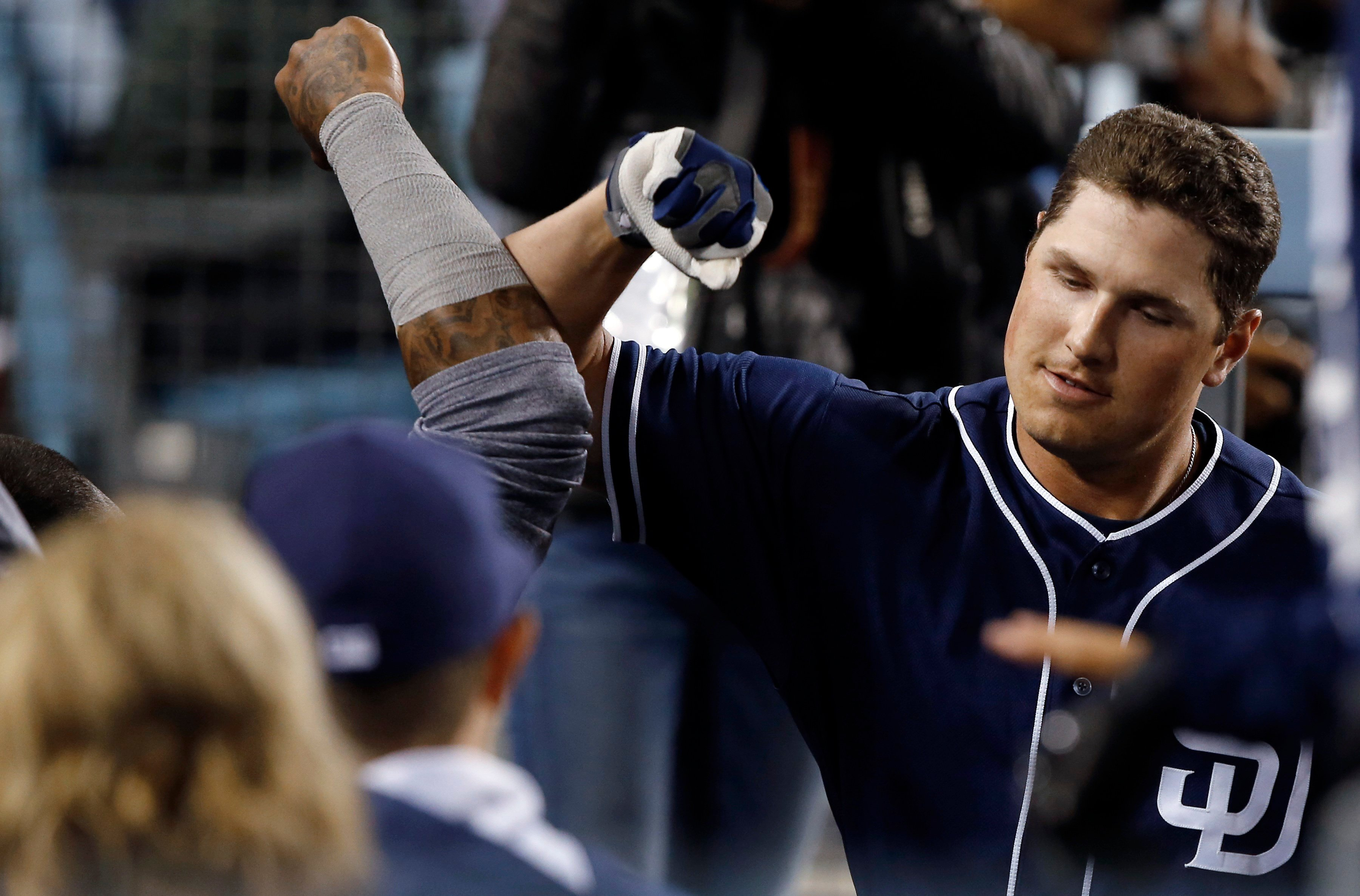 San Diego Padres' Hunter Renfroe, right, gets congratulations from teammates after hitting a solo home run during the fourth inning of the team's baseball game against the Los Angeles Dodgers in Los Angeles, Wednesday, April 5, 2017. (AP Photo/Alex Gallar