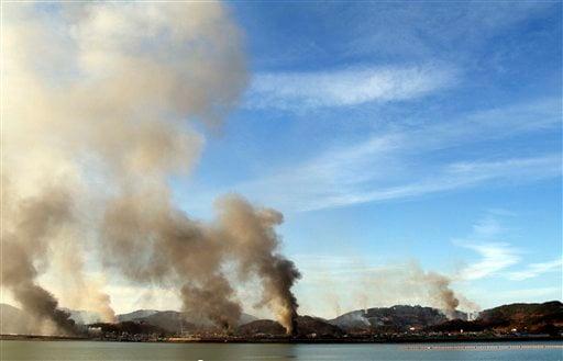 Smoke billow from Yeonpyeong island near the border against North Korea, in South Korea, Tuesday, Nov. 23, 2010. (AP)