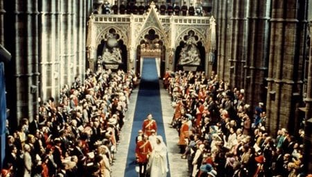 In this Nov. 14, 1963 file photo, Princess Anne and Captain Mark Phillips walk down the aisle after they had been married by the Archbishop of Canterbury, Dr. Michael Ramsey, in London's Westminster Abbey. (AP Photo/file)