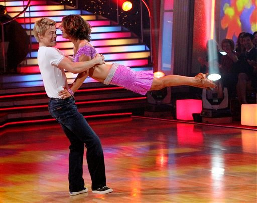 """In this publicity image released by ABC, Jennifer Grey, right, and her partner Derek Hough perform on the celebrity dance competition series, """"Dancing with the Stars,"""" on Monday, Nov. 22, 2010 in Los Angeles. (AP Photo/ABC, Adam Larkey)"""
