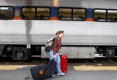 A passenger walks to catch a train at Union Station in Washington, Tuesday, Nov. 23, 2010, at the start of the Thanksgiving holiday travel rush.