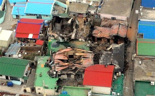 An aerial view shows destroyed houses on Yeonpyeong island, South Korea, Nov. 24, 2010, one day after North Korea's artillery attack on the island. (AP Photo/Yonhap, Kim Hyun-tae)