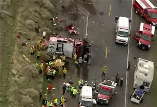 This image provided by KTLA-TV shows an aerial view of a crash site where a truck carrying a prison inmate fire crew collided with a car on a narrow highway north of Los Angeles, Nov. 23, 2010. (AP Photo/KTLA)