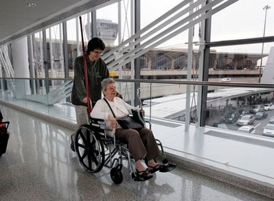 Marguerite Aswad, of Naples, Fla., is pushed in a wheelchair by her grandson Stephen Aswad, of Westfield, N.J., after arriving at Newark Liberty International Airport, Tuesday, Nov. 23, 2010, in Newark, N.J., for a holiday visit.