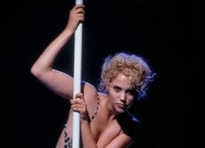 FILE - In this undated film publicity image originally released by MGM, actress Elizabeth Berkley appears in a scene from 'Showgirls.'