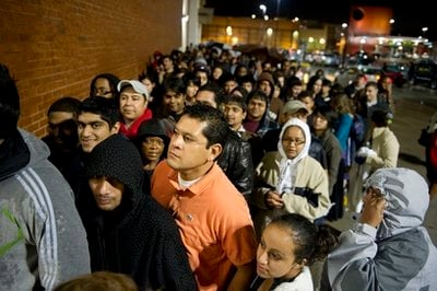 Jose Silva (wearing orange) waits in line for Best Buy to open at 5:00 a.m. in Atlanta Friday, Nov. 26, 2010. Silva, like hundreds of other early-morning shoppers, got in line the night before hoping to snag a deal on Black Friday.
