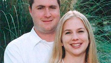 FILE - In this undated file photo released by Townsville Coroners Court on June 20, 2008, Gabe Watson, left, and his wife, Tina, pose on their engagement. (AP Photo/Townsville Coroners Court, File)