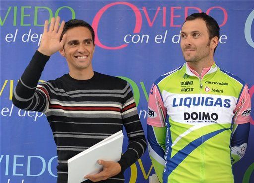 Cyclist Alberto Contador of Spain, left, waves after the Criterium cycling race next to Ivan Basso of Italy in Oviedo, Spain, Saturday Oct. 30, 2010.  (AP)
