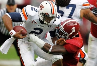 Auburn quarterback Cameron Newton (2) is sacked by Alabama's Courtney Upshaw (41) in the first half of their NCAA college football game, Friday, Nov. 26, 2010, at Bryant-Denny Stadium in Tuscaloosa, Ala.