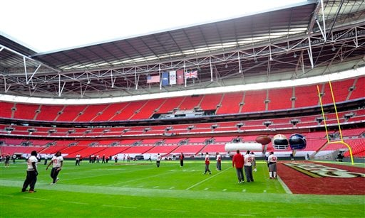 In this Oct. 30, 2010, file photo, the San Francisco 49ers work out during an NFL football pracrice at Wembley Stadium, London. (AP Photo/Tom Hevezi, File)