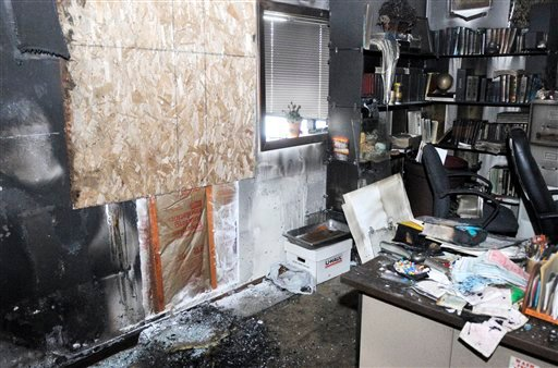 This photo shows the inside of Mohammed Siala's office, where an arsonist threw a bottle of accelerant into the mosque in Corvallis, Ore. Sunday, Nov. 28, 2010. (AP Photo/Corvallis Gazette-Times, Jesse Skoubo)