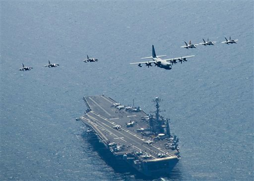 This image provided by the U.S. Navy shows a Marine Corps C-130 Hercules leads a formation of F/A-18C Hornets, right, and A/V-8B Harriers as they fly in formation in the seas east of the Korean peninsula on July 27, 2010. (AP Photo/US Navy - Charles Oki)