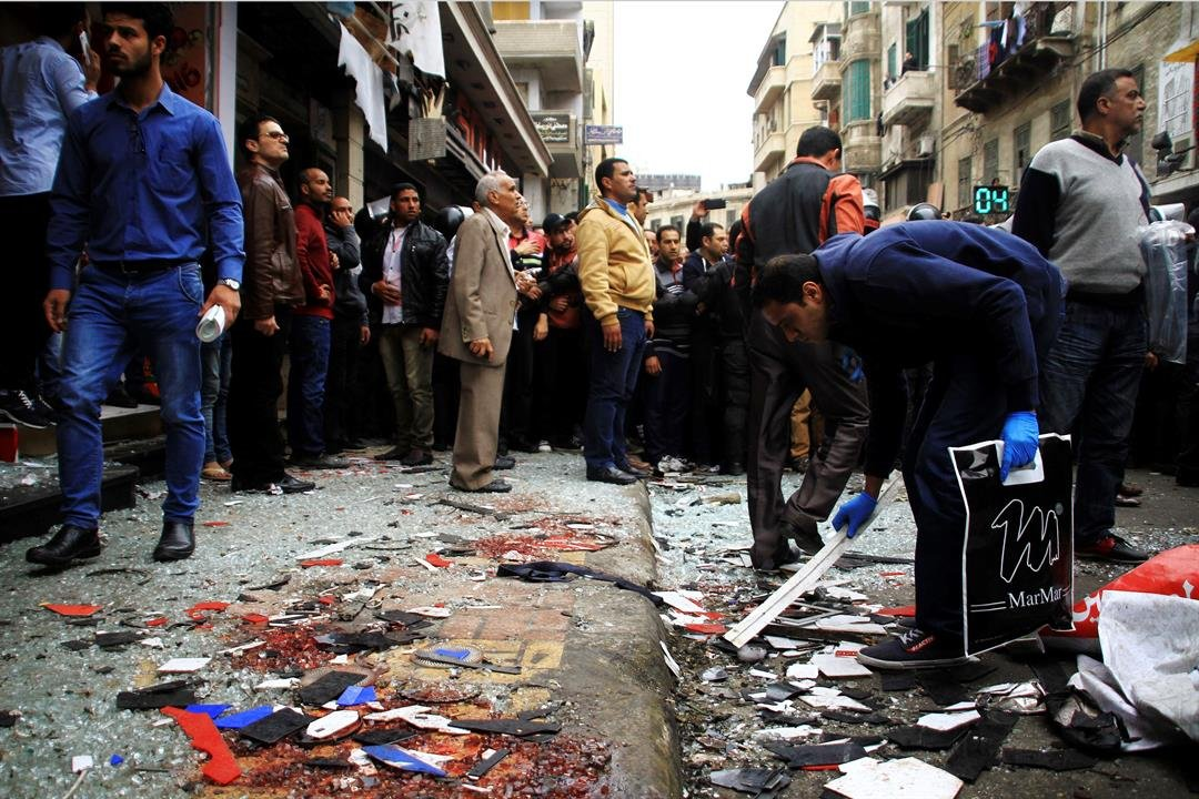 People clean up debris after an explosion hit Saint Mark's Cathedral in the coastal city of Alexandria, the historic seat of Christendom in Egypt, Sunday, April 9, 2017, killing several people. (AP Photo/Hazem Gouda)