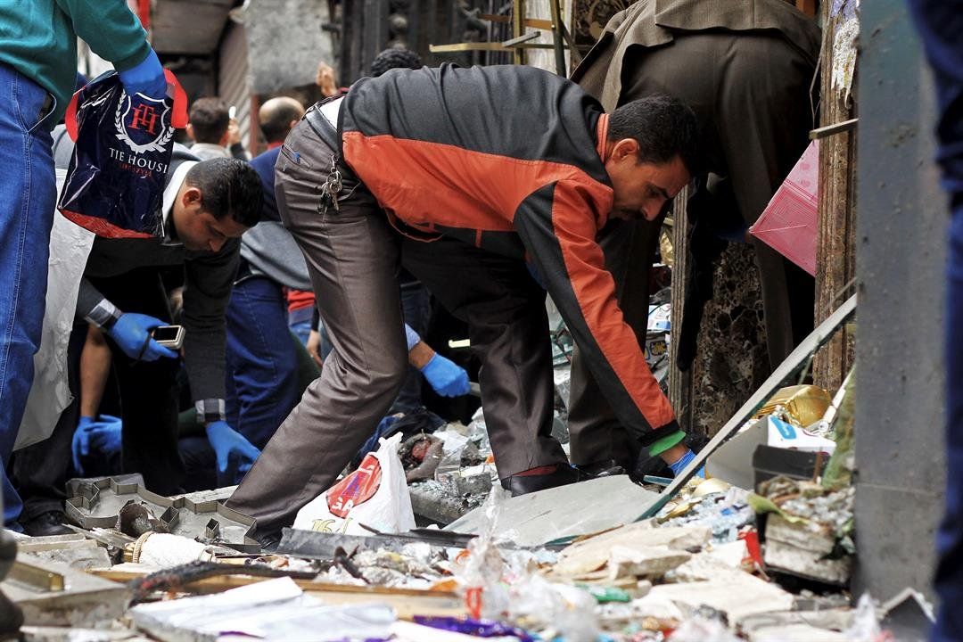 People search through debris after an explosion hit Saint Mark's Cathedral in the coastal city of Alexandria, the historic seat of Christendom in Egypt, Sunday, April 9, 2017. (AP Photo/Hazem Gouda)