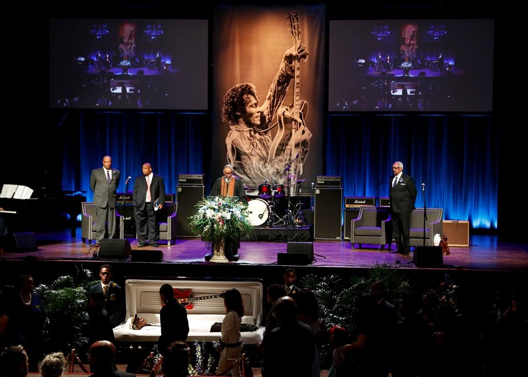 Family and friends slowly walk past the casket of rock 'n' roll legend Chuck Berry at the start of his celebration of life Sunday, April 9, 2017, in St. Louis. (AP Photo/Jeff Roberson)