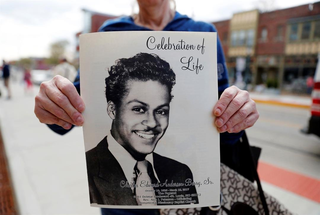 A woman holds a program outside The Pageant, a concert venue where a celebration of life was held for rock 'n' roll legend Chuck Berry and where Berry often performed, Sunday, April 9, 2017, in St. Louis. (AP Photo/Jeff Roberson)