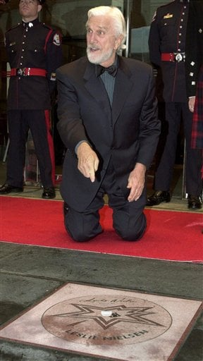 FILE - In this file photo taken June 1, 2001, actor Leslie Nielsen points to his star as he was inducted into the Walk of Fame along King Street in Toronto.