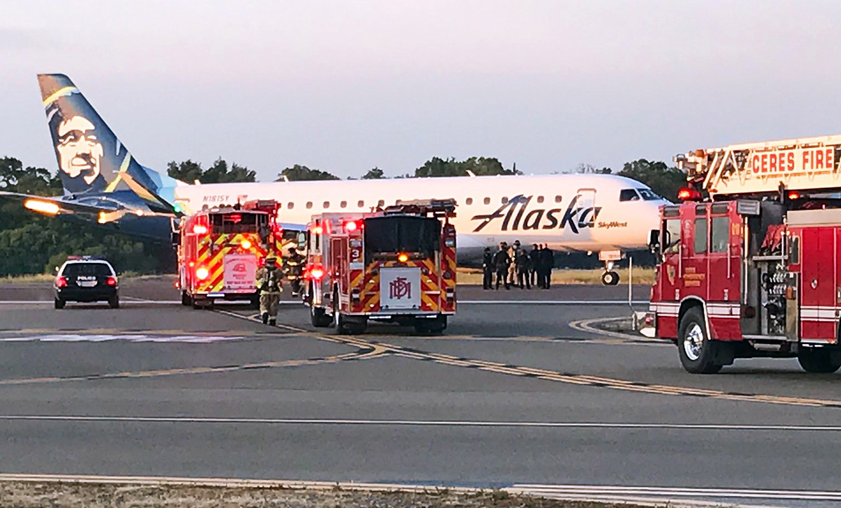 This photo provided by the Modesto, Calif., Fire Department shows an Alaska Airlines Embraer 175 twin jet after it made an unscheduled landing at the Modesto airport Sunday, April 9, 2017. (Modesto Fire Department via AP)