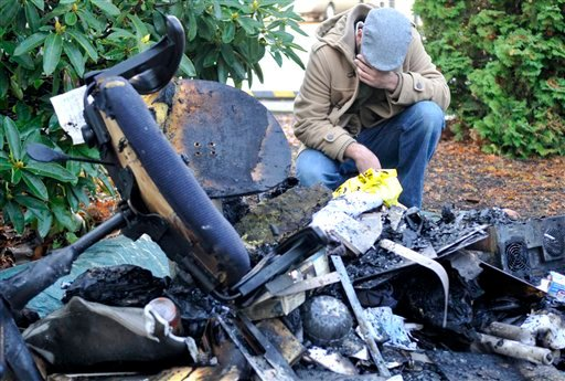 Ahson Saeed, of Corvallis, Ore., reacts over a pile of burnt debris pulled from a local mosque in Corvallis, Ore. Sunday, Nov. 28, 2010 where an alleged arsonist set a fire in the early morning hours.