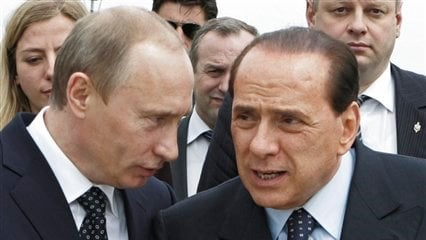 Italy's Premier-elect Silvio Berlusconi, right, and Russia's President Vladmir Putin seen after a joint news conference following talks in Berlusconi's 'Villa Certosa' in Porto Rotondo, on the island region of Sardinia, Italy. (AP)