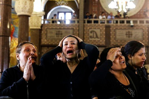 Women cry during the funeral for those killed in a Palm Sunday church attack in Alexandria Egypt, at the Mar Amina church, Monday, April 10, 2017. (AP Photo/Samer Abdallah)
