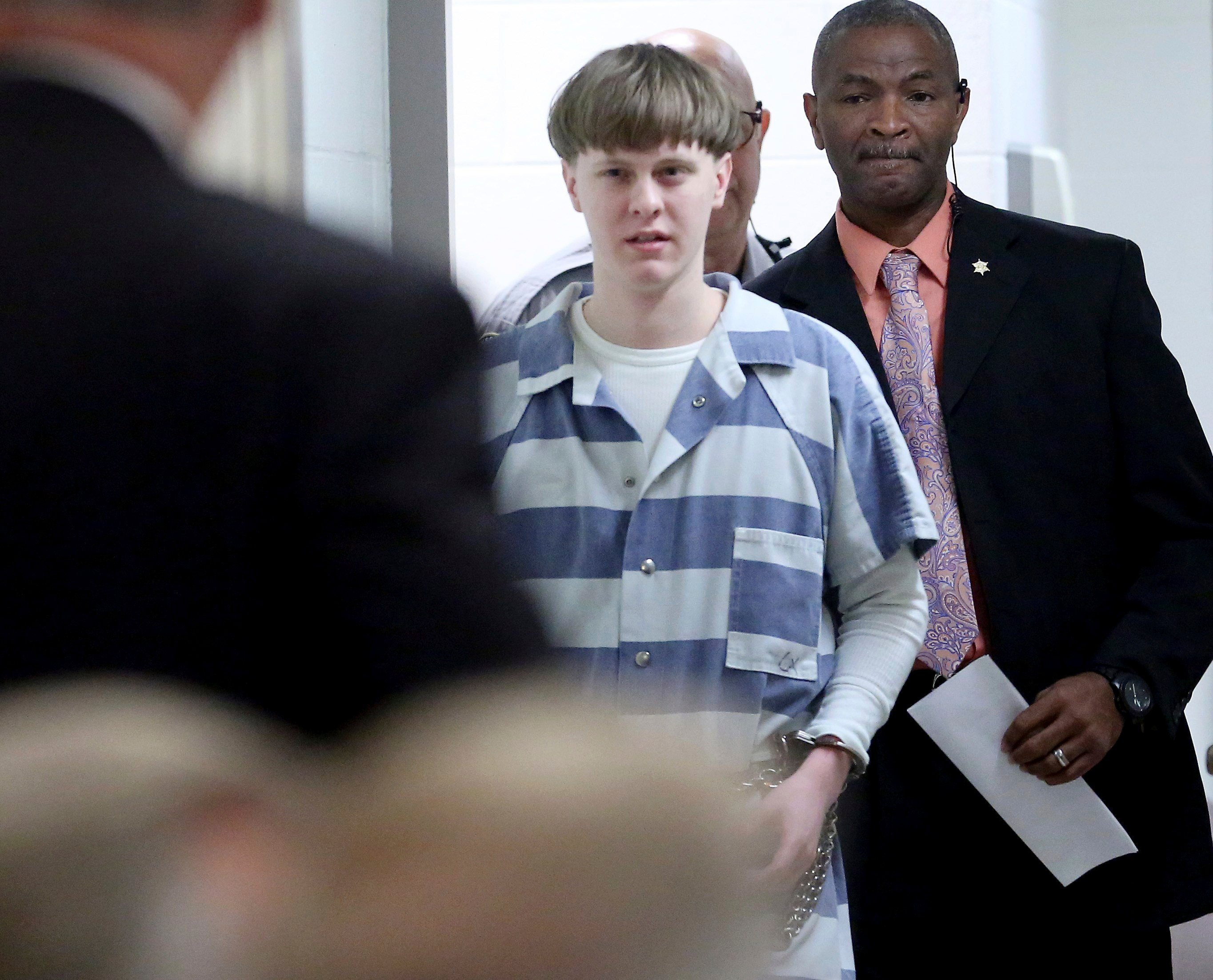 Dylann Roof enters the court room at the Charleston County Judicial Center Monday, April 10, 2017, to enter his guilty plea on murder charges in Charleston, S.C. (Grace Beahm/The Post And Courier via AP, Pool)