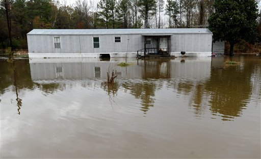 A mobile home is surrounded by flood waters on Mt. Tabor Rd. in Morgan County, near the city of Hartselle, Ala., Nov. 30, 2010. Flooding closed several roads in the county but no injuries were reported. (AP Photo/The Decatur Daily, Gary Cosby Jr.)