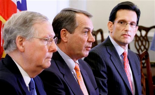 House Minority Leader John Boehner of Ohio, center, accompanied by Senate Minority Leader Mitch McConnell of Ky., left, and House Minority Whip Eric Cantor of Va. speaks during a news conference on Capitol Hill. (AP Photo/Harry Hamburg)
