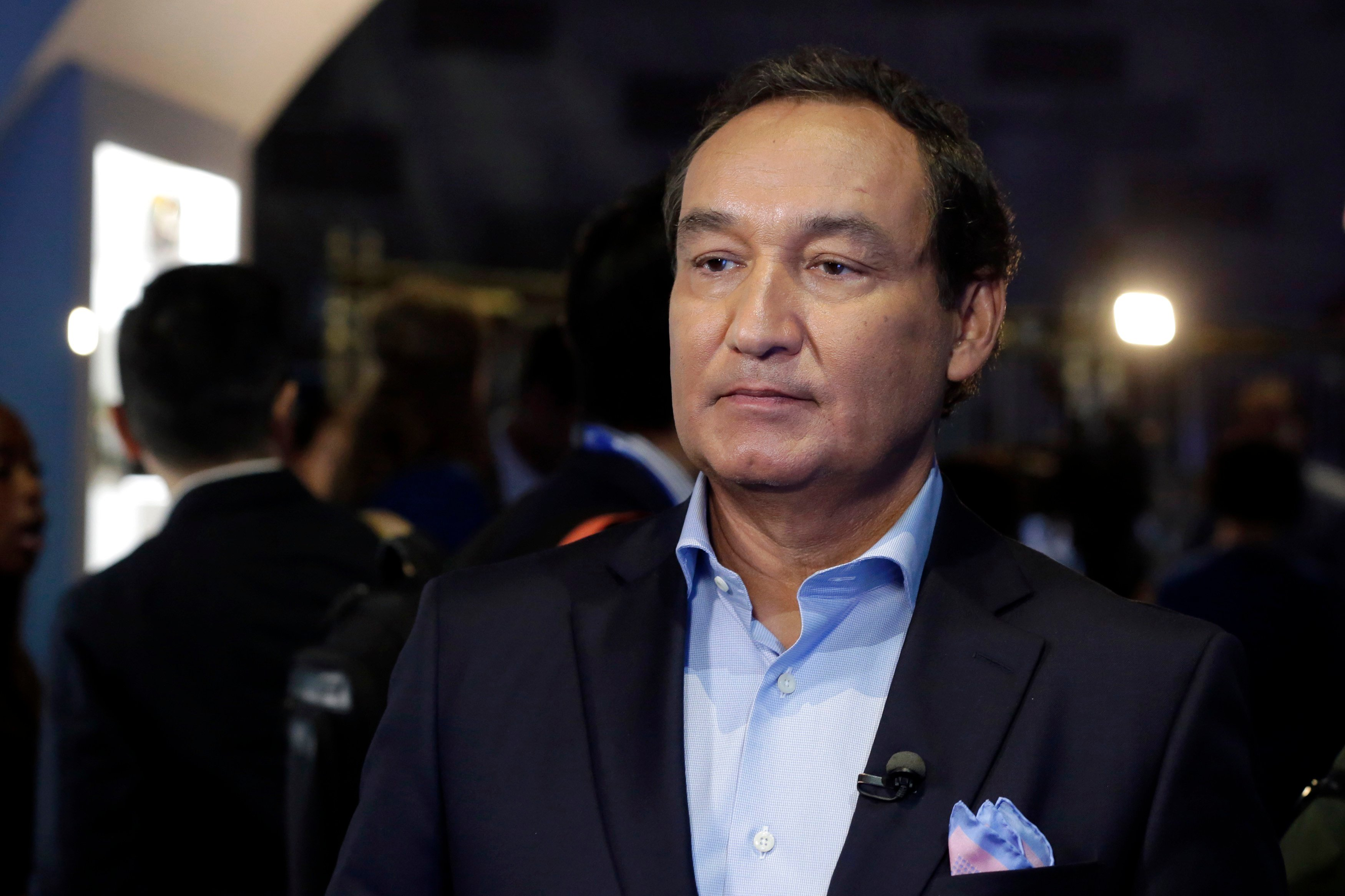 FILE - In this Thursday, June 2, 2016, file photo, United Airlines CEO Oscar Munoz waits to be interviewed, in New York, during a presentation of the carrier's new Polaris service, a new business class product that will become available on trans-Atlantic