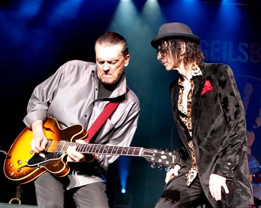 The American iconic rock band the J. Geils Band with lead guitarist J. Geils and lead vocalist Peter Wolf performs during the first of two sold out shows at the Bank of America Pavilion in Boston, Saturday, August 6, 2011. (AP Photo/Robert E. Klein)