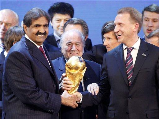 FIFA President Joseph Blatter is flanked by Russian Deputy Prime Minister Igor Shuvalov, right, and Sheikh Hamad bin Khalifa Al-Thani, Emir of Qatar.