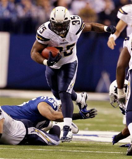 San Diego Chargers fullback Mike Tolbert, top, leaps over Indianapolis Colts defensive tackle Fili Moala for a short gain in the first quarter of an NFL football game in Indianapolis, Sunday, Nov. 28, 2010. (AP Photo/Darron Cummings)