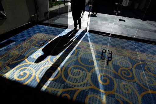 In this Nov. 30, 2010 photo, a job applicant walks through the front door of a career fair, in San Diego. (AP Photo/Gregory Bull)