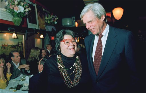 """FILE - In this April 27, 1993 file photo, restaurateur Elaine Kaufman, left, stands with author George Plimpton at her restaurant """"Elaines"""" in New York. Kaufman, whose East Side establishment became a haven for show business and literary notables."""
