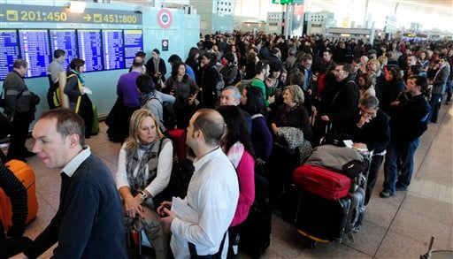 Passengers wait for news about their flights at T1 terminal of El Prat Llobregat airport in El Prat Llobregat, near Barcelona, on Saturday, Dec. 4, 2010. (AP Photo/Manu Fernandez)