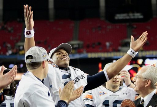 Auburn quarterback Cameron Newton (2) gestures to the crowd after defeating South Carolina 56-17 in the Southeastern Conference championship NCAA college football game Saturday, Dec. 4, 2010 in Atlanta. (AP Photo/John Bazemore)