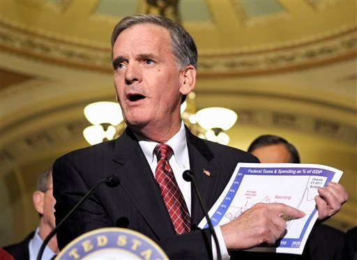 In this Feb. 2, 2010 file photo, Sen. Judd Gregg, R-N.H., then-ranking Republican on the Senate Budget Committee. meets with reporters on Capitol Hill in Washington. (AP Photo/Cliff Owen, File)