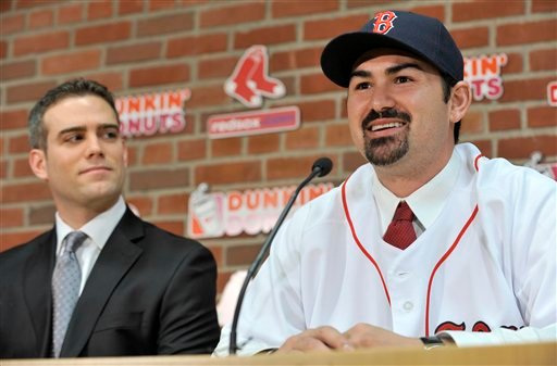 New Boston Red Sox first baseman Adrian Gonzalez, right, speaks to reporters as Red Sox General Manager Theo Epstein, left, looks on during a news conference at Fenway Park in Boston, Monday, Dec. 6, 2010.