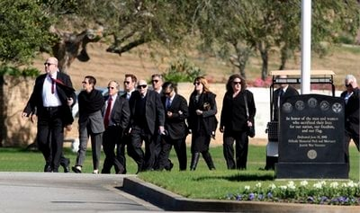 Guests arrive at a funeral for Hollywood publicist Ronni Chasen at Hillside Memorial Park and Mortuary on Sunday, Nov. 21, 2010, in Los Angeles.