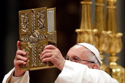Pope Francis presides over a solemn Easter vigil ceremony in St. Peter's Basilica at the Vatican, Saturday.