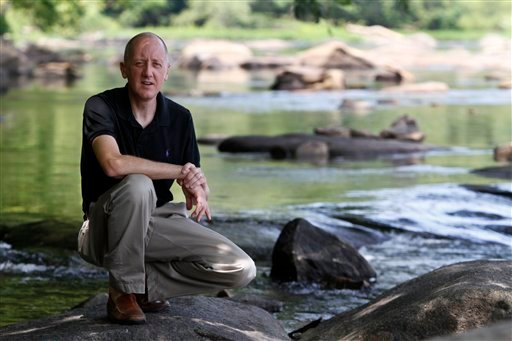 In this Thursday July 22, 2010 photo, Kevin Price poses on the banks of the James River in Richmond, Va. (AP Photo/Steve Helber) Summary