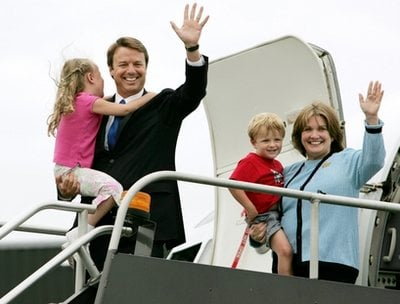 FILE - In this July 27, 2004 file photo, Sen. John Edwards, D-N.C., left, holds his daughter Emma Claire, 6, as his wife Elizabeth, holds their son Jack, 4,while departing Edwards' campaign plane in Boston.