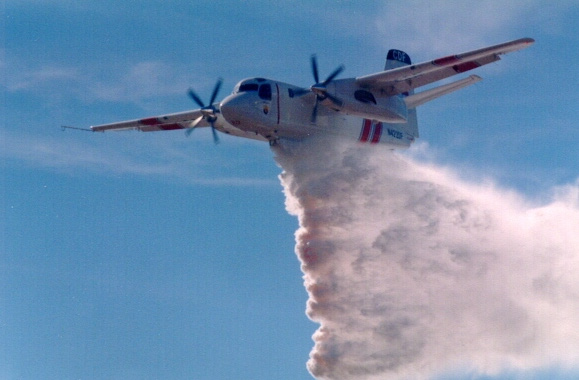 The retardant used to slow or retard the spread of a fire is a slurry mix consisting of a chemical salt compound, water, clay or a gum- thickening agent, and a coloring agent.