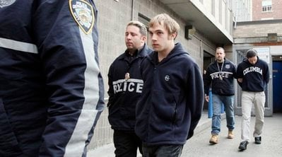 Columbia University students Adam Klein, center, and Jose Perez, right are walked from the New York Police Department's 25th Precinct in Manhattan after they were arrested with three other students on Tuesday Dec. 7, 2010 in New York.